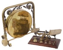A brass and copper table gong, and brass and mahogany postal scales(9)