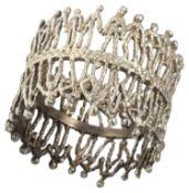 Stuart Leslie Devlin silver-gilt figural napkin ring, hallmarked London 1974