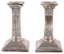 A pair of Edwardian silver dwarf candlestick, hallmarked Sheffield 1909