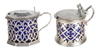 Two Victorian silver mustard pots, with blue glass liners