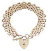 A 9ct gold three bar gate bracelet