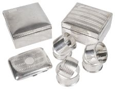 A collection of George V and later silver, cigarette boxes and napkin rings