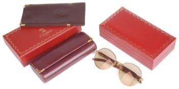 "A set of Cartier """"Giverny"""" sunglasses (3)"