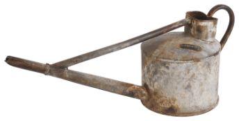 A vintage galvanised watering can