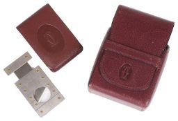 A Must de Cartier cigar cutter with burgundy leather pouch (3)
