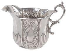 A Victorian silver cream jug, hallmarked Birmingham 1893