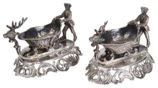 An unusual pair of Continental white metal figural sleigh salts