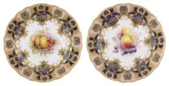 A pair of Royal Worcester porcelain cabinet plates, circa 1912
