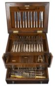 An oak canteen of silver plated flatware, 20th century