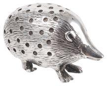 An Edwardian silver novelty hedgehog pin cushion, hallmarked Birmingham 1904