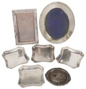 A set of four Art Deco silver trays, hallmarked London 1928 & 1930