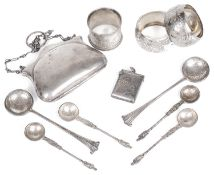 A collection of Victorian and later silver, napkin rings, vesta case, spoons and purse