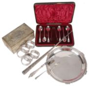 A collection of Victorian and later silver, including boot hook, napkin rings, butter knife, salver