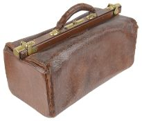 An early 20th century brown leather Gladstone bag