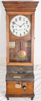 Lot 12 - An oak cased International Time Recording Ltd clocking in/clocking out clock