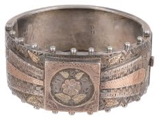 A Victorian silver and gold overlay hinged bangle