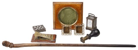 A collection of Victorian and later desk items and a character face carved swagger stick