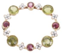 A delicate Edwardian peridot and pink gem circle posy brooch