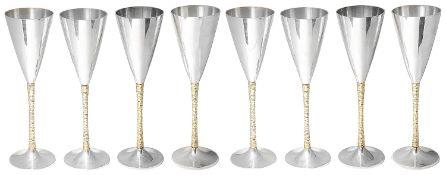 Stuart Leslie Devlin set of eight parceil-gilt silver champagne flutes, hallmarked London 1977