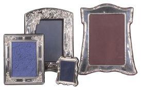 A collection of four contemporary silver photo frames