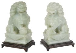 A pair of Chinese green hardstone carved Buddhistic lions, mid 20th century