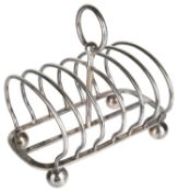 A Victorian silver six section toast rack, hallmarked Sheffield 1880