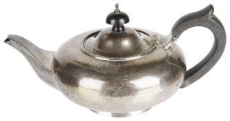 A George V silver bachelor's teapot, hallmarked London 1928