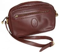 A Cartier burgundy leather messenger bag, with dust bag