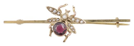 An Edwardian garnet and seed pearl set fly bar brooch
