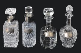 Four glass decanters with silver decanter labels, 20th century