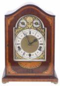 A German mahogany and satinwood chiming table clock