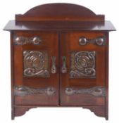An Arts and Crafts mahogany pipe wall cabinet, early 20th century