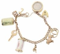 A 9ct rose gold curb link charm bracelet with heart padlock fastening