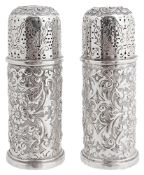 A pair of Victorian silver pepperettes, hallmarked London 1890