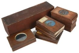 A large collection of wooden mounted magic lantern slides