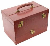 An Asprey red leather travelling vanity box and outer cover