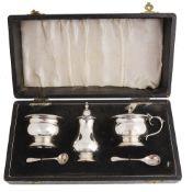 A cased three piece silver cruet set, Birmingham 1964/1965/1967