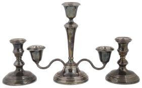 Pair of silver candlesticks; silver three two branch candelabra