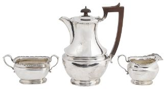A George V three piece silver tea service, hallmarked Birmingham 1926