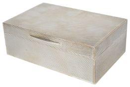 A George VI silver cigarette box, hallmarked London 1938