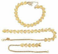 A yellow metal foliate necklace and bracelet