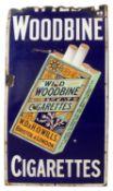 A vintage 'Wild Woodbines' enamelled advertising sign