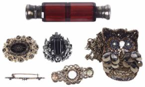 A cranberry glass double ended scent bottle and brooches
