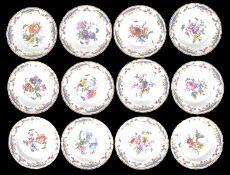A suite of twelve KPM porcelain plates, late 19th century