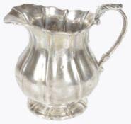 A Victorian Irish silver cream jug, hallmarked Dublin 1823