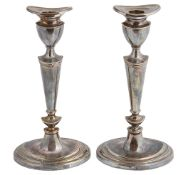 A pair of silver candlesticks, hallmarked London 2002