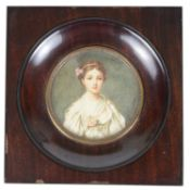A late 19th century portrait miniature of a young woman on ivory