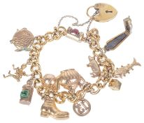 A gilt curb link bracelet with heart padlock fastening