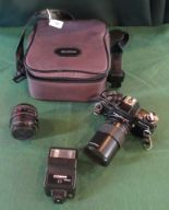 Lot 50 - A Pratika SLR camera and accessories in fitted case.