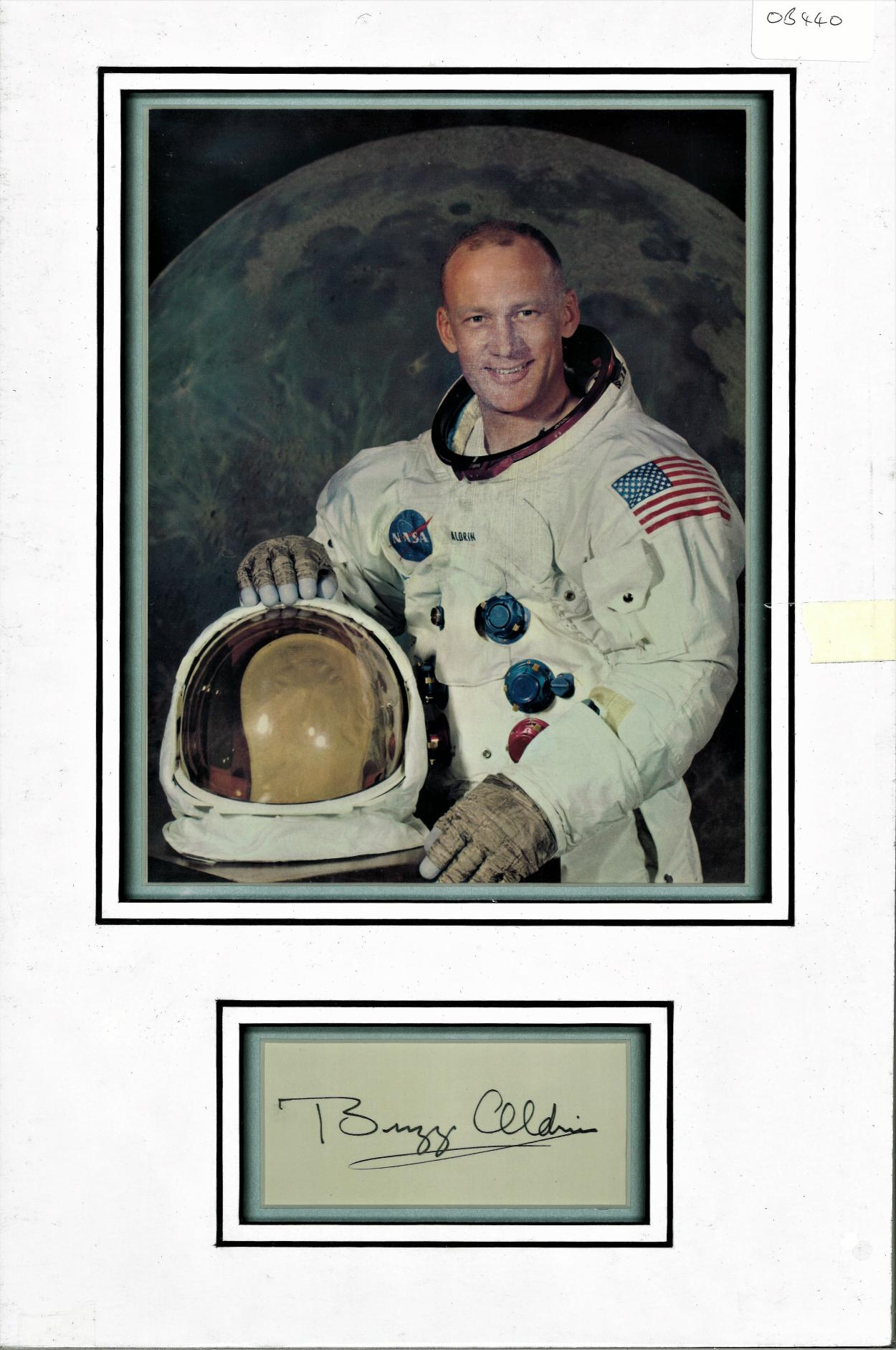 Lot 64 - Buzz Aldrin signed autograph presentation. High quality professionally mounted 17 x 11 inch